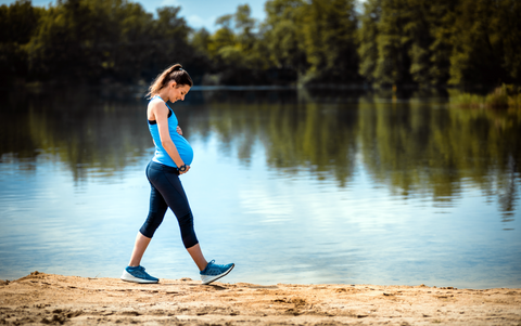 Pregnant Woman On A Walk