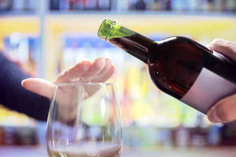 Woman's Hand Rejecting More Alcohol