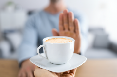 Woman's Hand Rejecting Coffee