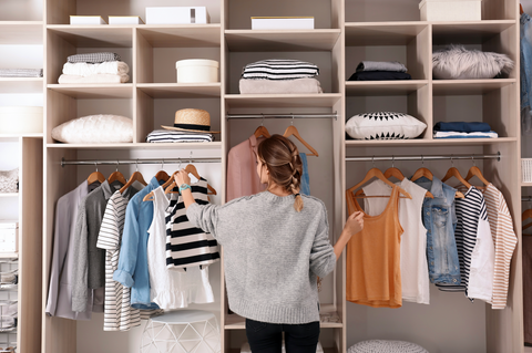 Woman Looking Through Clothing
