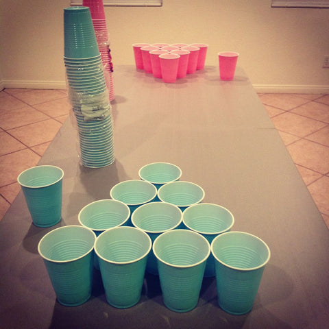 gender reveal party game, beer pong, pink and blue cups
