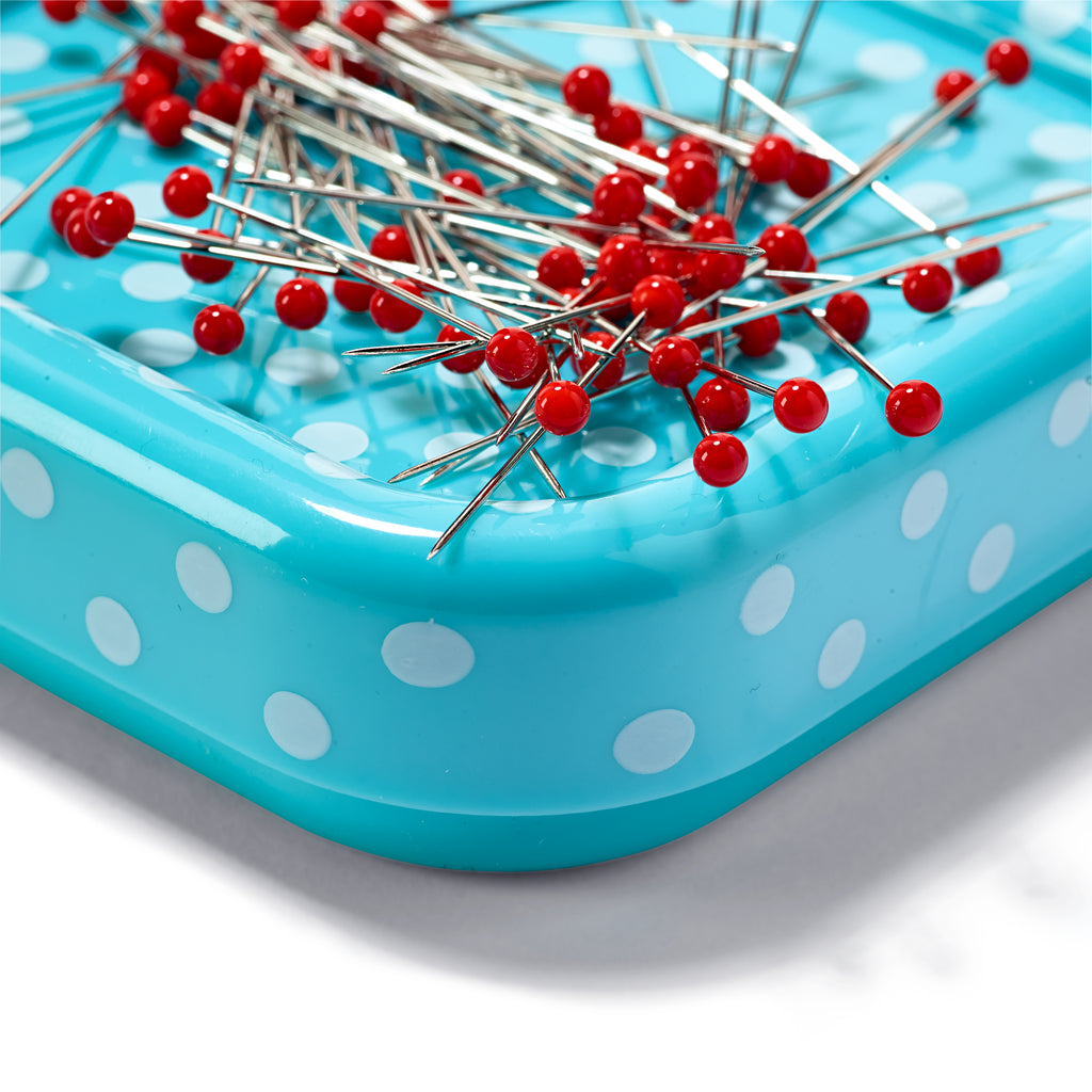 Magnetic pincushion with glass-headed pins