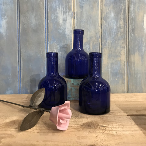 Three recycled glass bottles in dark blue.