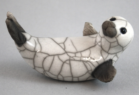 Seal Pup on Back white raku Chloe Harford