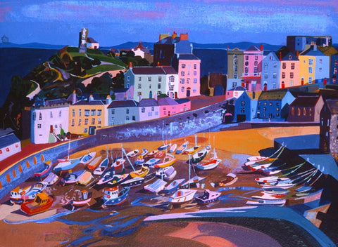 Tenby harbour with boats beached on the sand below the sea wall and brightly coloured Victorian houses . Painted in watercolour.