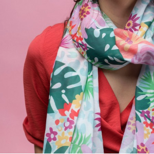 Lightweight Women's scarf with pastel flowers and tropical leaves on a white background. designed scarf