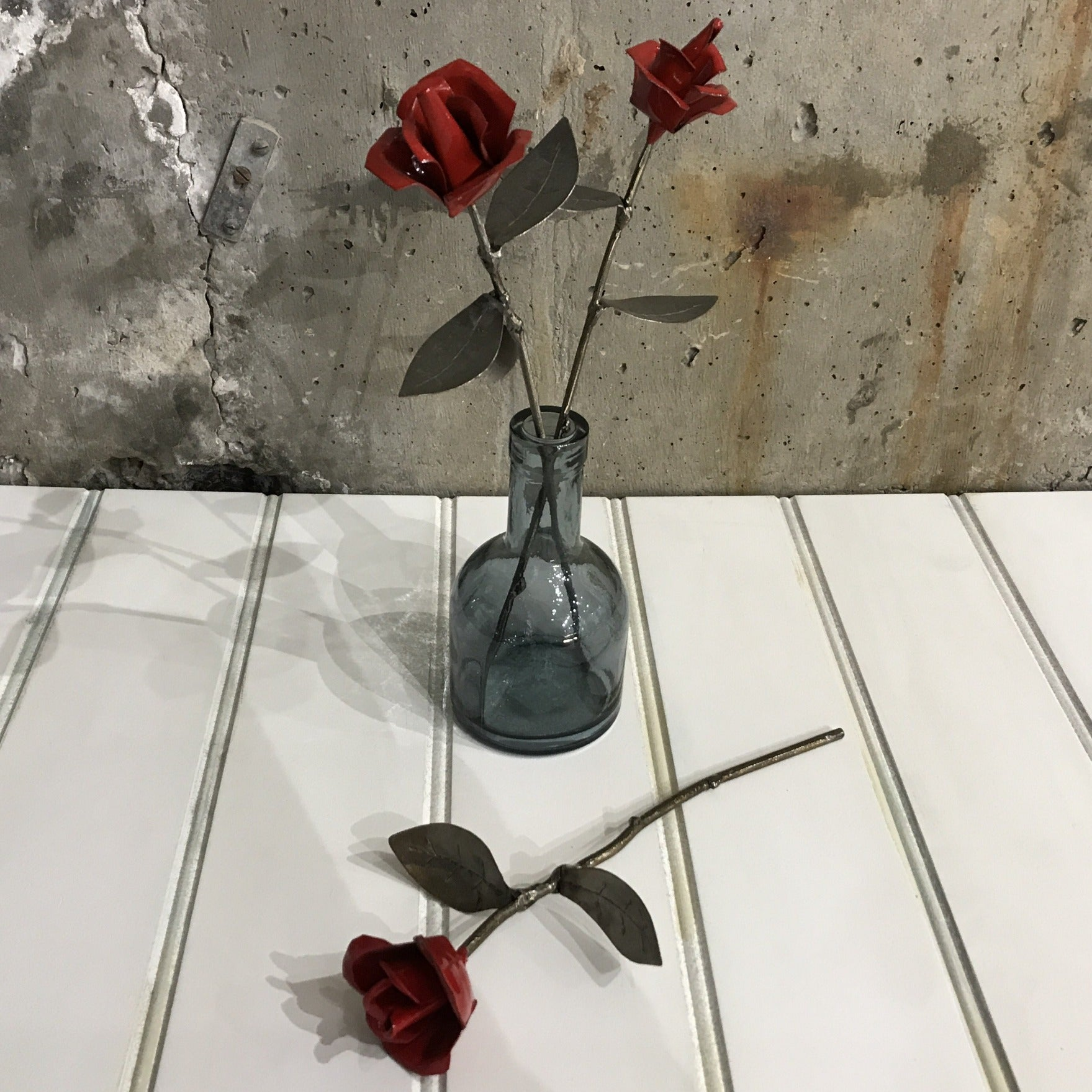 Red metal rose sold on behalf of Les Brooks