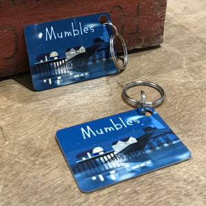 Metal keyring illustarted with a view of Mumbles pier and lighthouse at night.