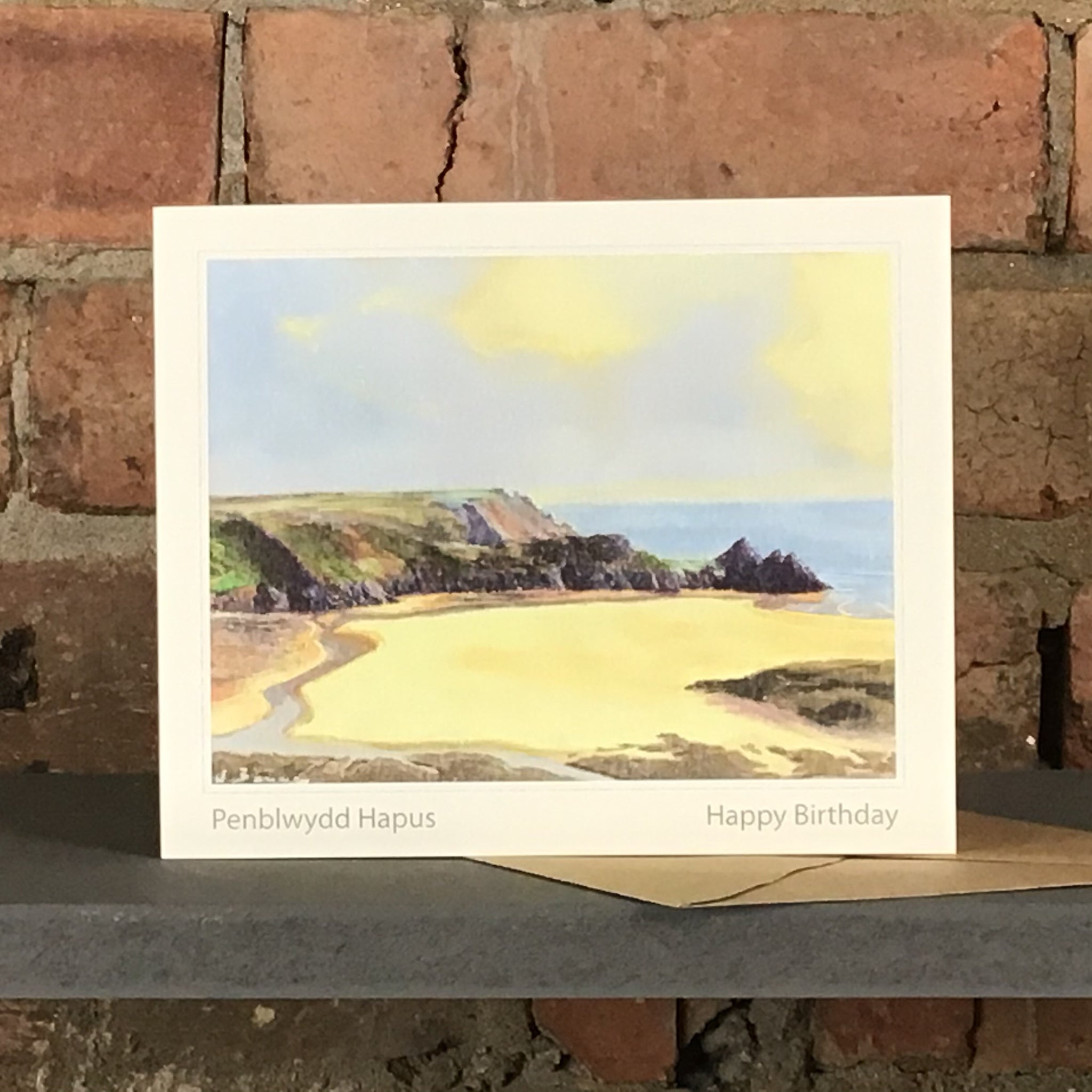 BAY OF LIGHT, THREE CLIFFS - HAPPY BIRTHDAY GREETINGS CARD SOLD ON BEHALF OF R N BANNING
