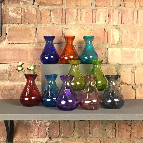 Group of different coloured glass bud vases