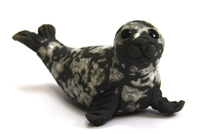 Seal pup on flippers grey raku Chloe Harford
