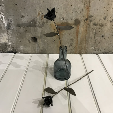 Metal long stemmed rose with black enamel  petals and  distressed warm silver leaves.