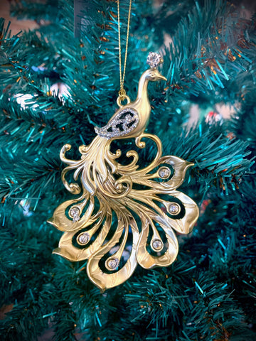 Gold peacock Christmas tree ornament in an Art Nouveau style