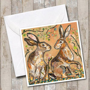 Hares Looking at you Greeting card by Dawn Maciocia