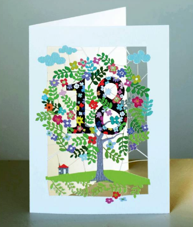 paper cut eighteenth birthday card with the 18 in the branches of a colourful lazer cut tree.