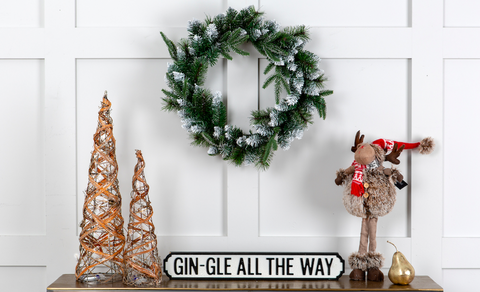 Gin-gle All the Way bar sign in a Christmas home set-up.