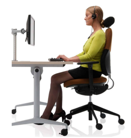 working with standing desk at home with headphone on