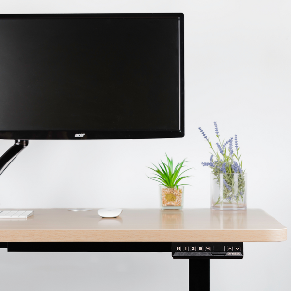 An electric standing desk can increase your productive