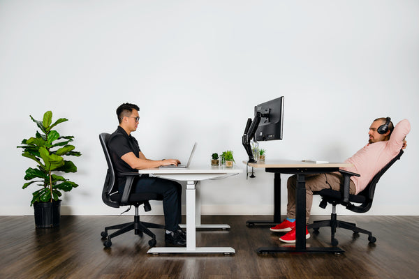 Two Men Working at Ergonomic Electric Sit-Stand Desks Office Chairs - EFFYDESK (Vancouver, B.C)