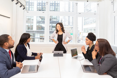 Facilitator and other office worker in Group Meeting