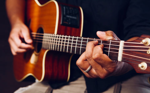 playing a instrument like guitar and relax yourself