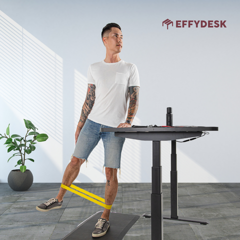 Doing stretching beside your standing desk