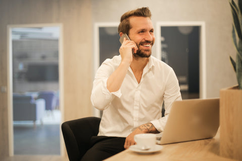 Man Talking on Phone Smiling and communicate with his team