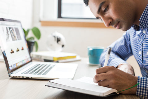 Man Writing in Notebook to release tension
