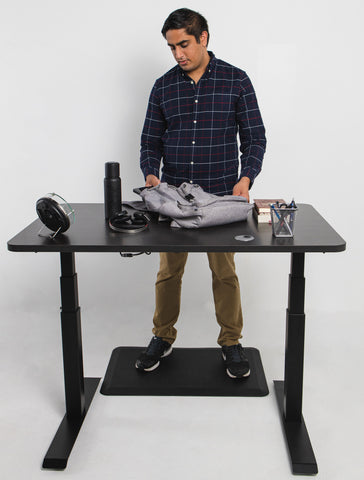 man standing in front of tall standing desk