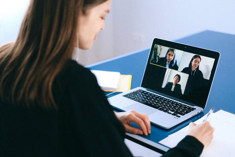 A business woman running a video conference