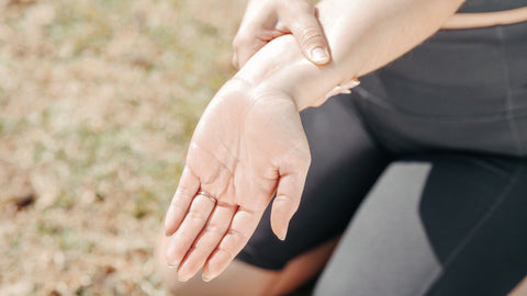 A computer worker is having pain from carpal tunnel syndrome