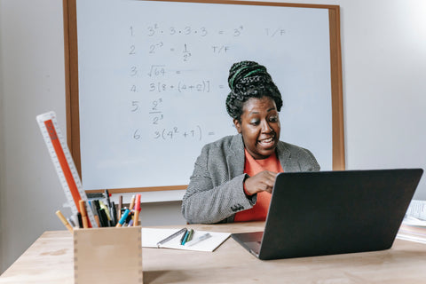 Woman at laptop learn how to talk herself
