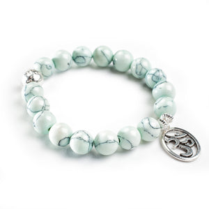 Tranquility Bracelet - Reconstituted Turquoise with Sterling Silver Guru bead and choice of charm