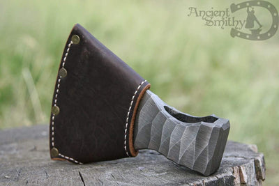 Hand forged axe head, survival hand tool
