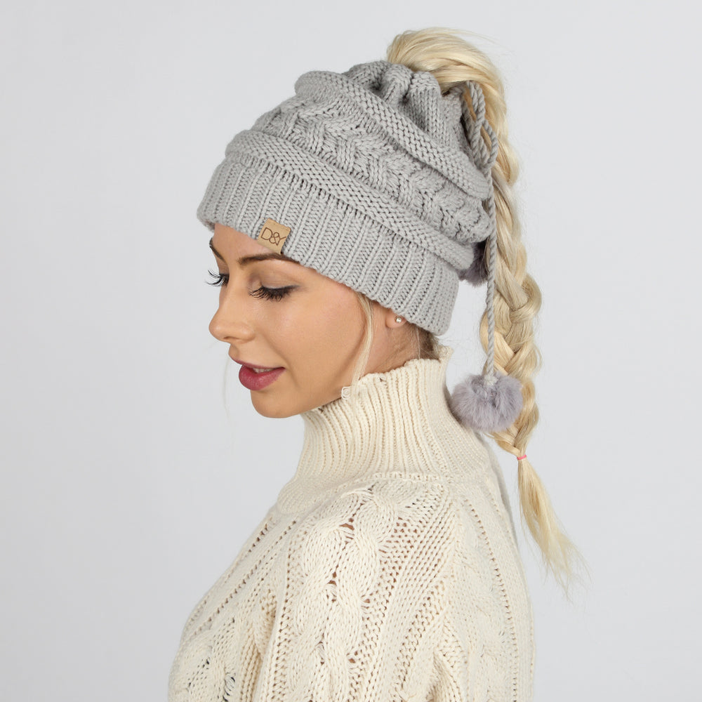 Beth Adjustable Cable Knit Ponytail Beanie with Faux Fur Poms & Suede Tab