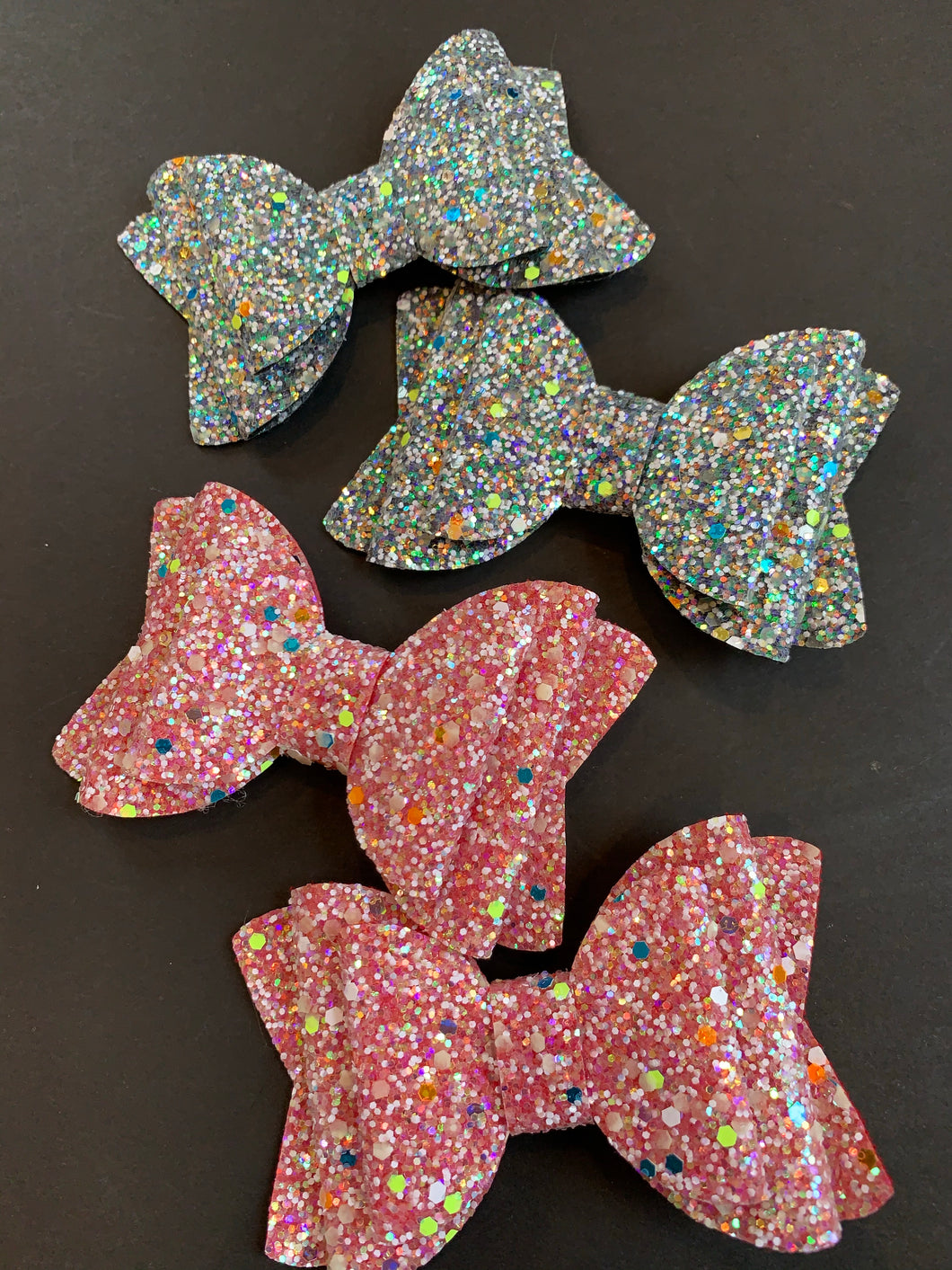 Mutli Glitter Glow in the Dark 4 Inch Bow on Alligator Clip
