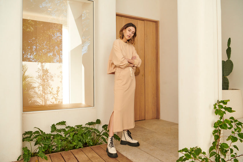 The Game Oversized Sweatshirt and the Game Track Skirt in Camel.