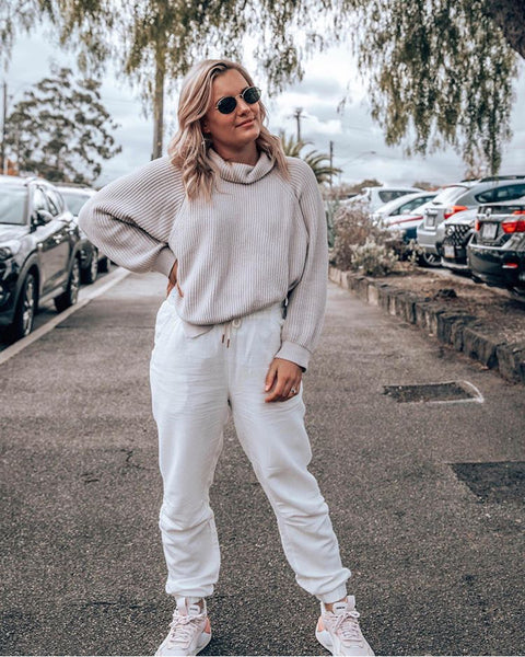 Olivia White wears the Cove Layered Knit and Field Pants