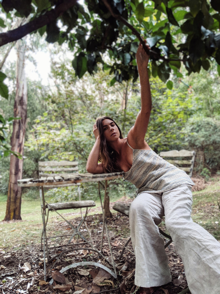 Christelle wears the Nomad Handloom Cami and the Mohave Pants.