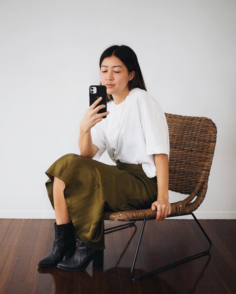 Nora from @nrahmichelle styles the Highlands Skirt in Khaki with a white tee