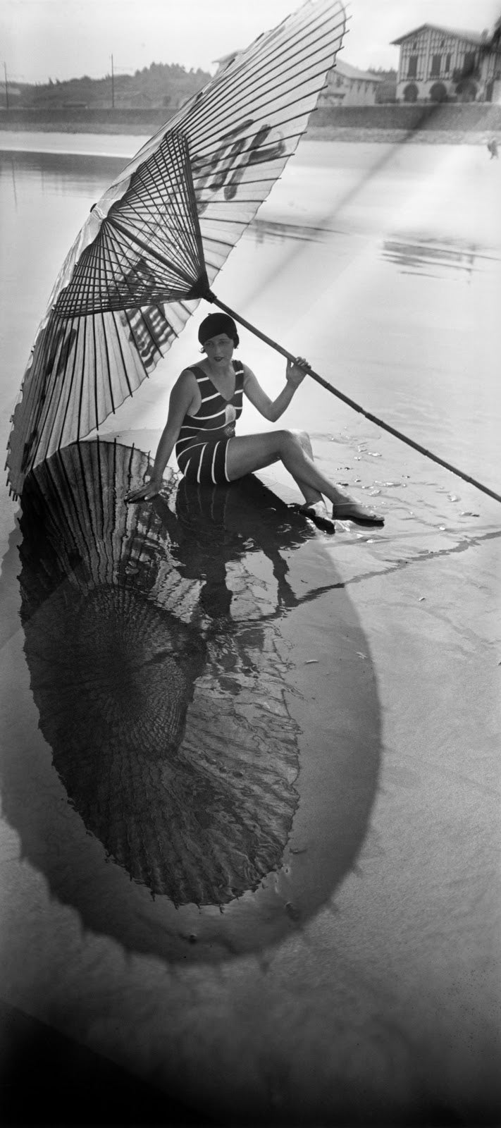 Jacques-Henri Lartique Woman Posing on the beach with umbrella