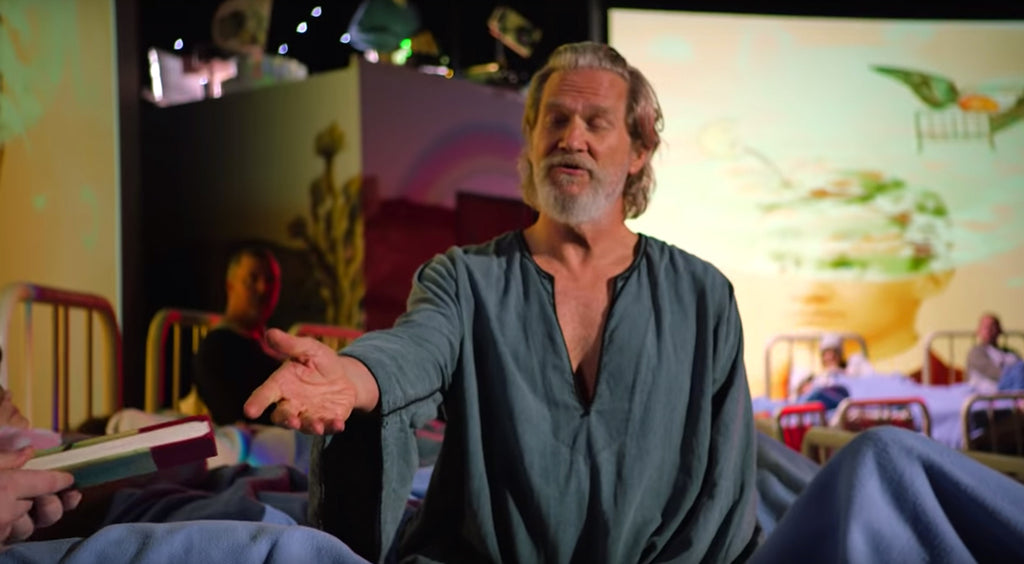 Jeff Bridges reaching out his arm.