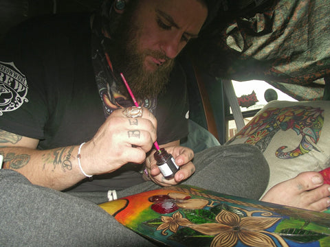 "Working on a skate deck ""California cruisin"" in the old van Le chateau Majíc"