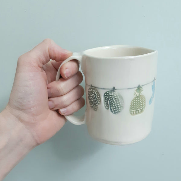 SECONDS - Knitwear a clothes line - blues and greens - hand built pottery mug