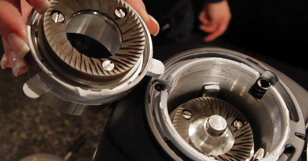 Burrs outside of a taken-apart grinder