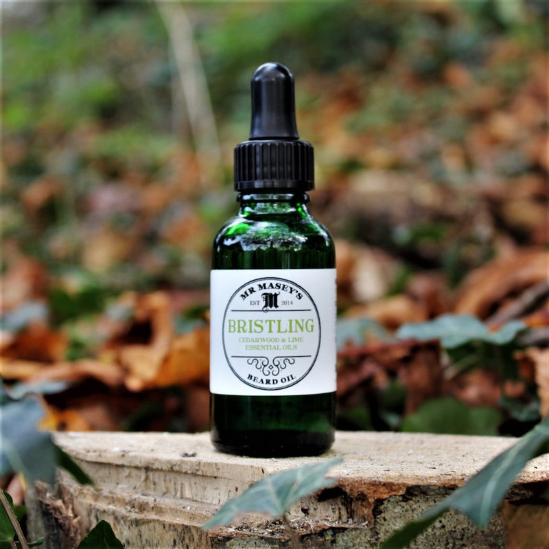 Bristling Beard Oil Bottle in autumnal woodland setting