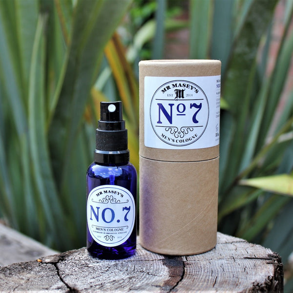Mr Masey's No.7 Vegan Cologne Bottle and box on a tree stump