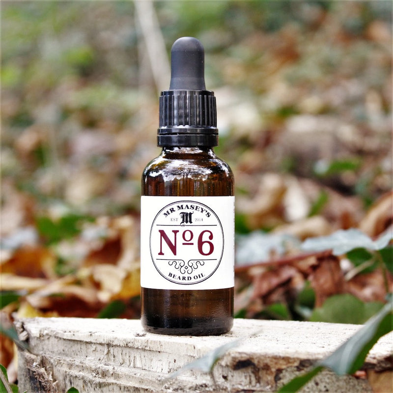 Mr Masey's No.6 Beard Oil bottle in autumnal woodland setting