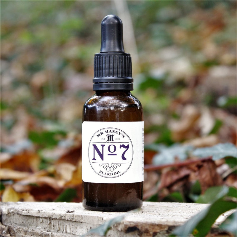Mr Masey's No.7 Beard Oil bottle in autumnal woodland setting