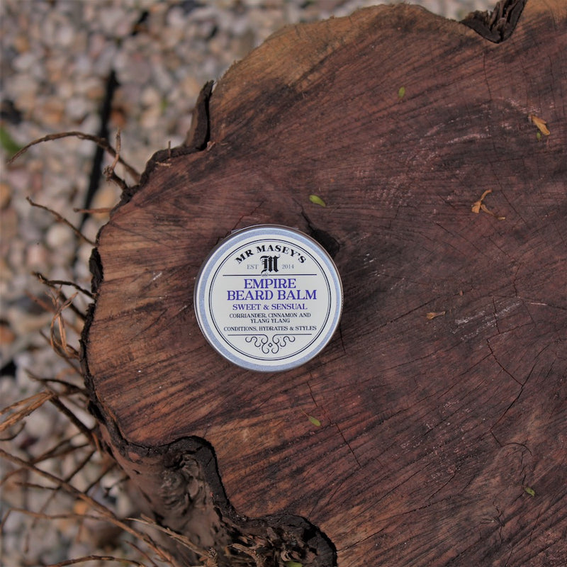 Empire Beard Balm on a log
